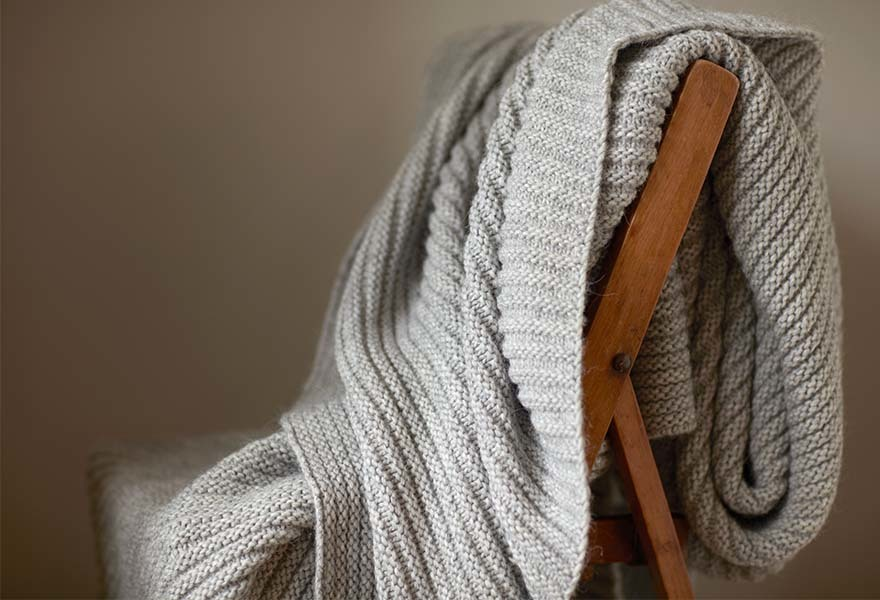 Grey Knitted Blanket on a Chair