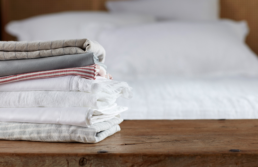 A Stack of Different Types of Bed Linen
