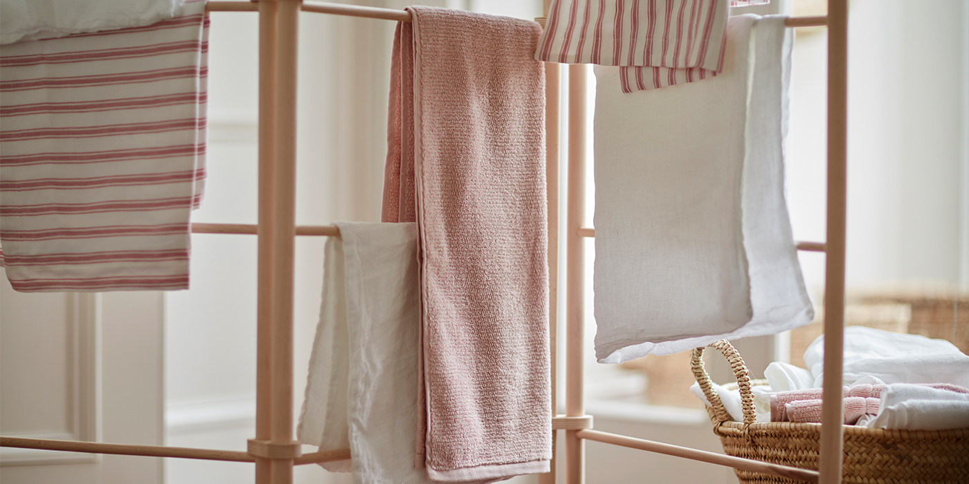 Towels and Bed Linen Drying On a Clothes Horse