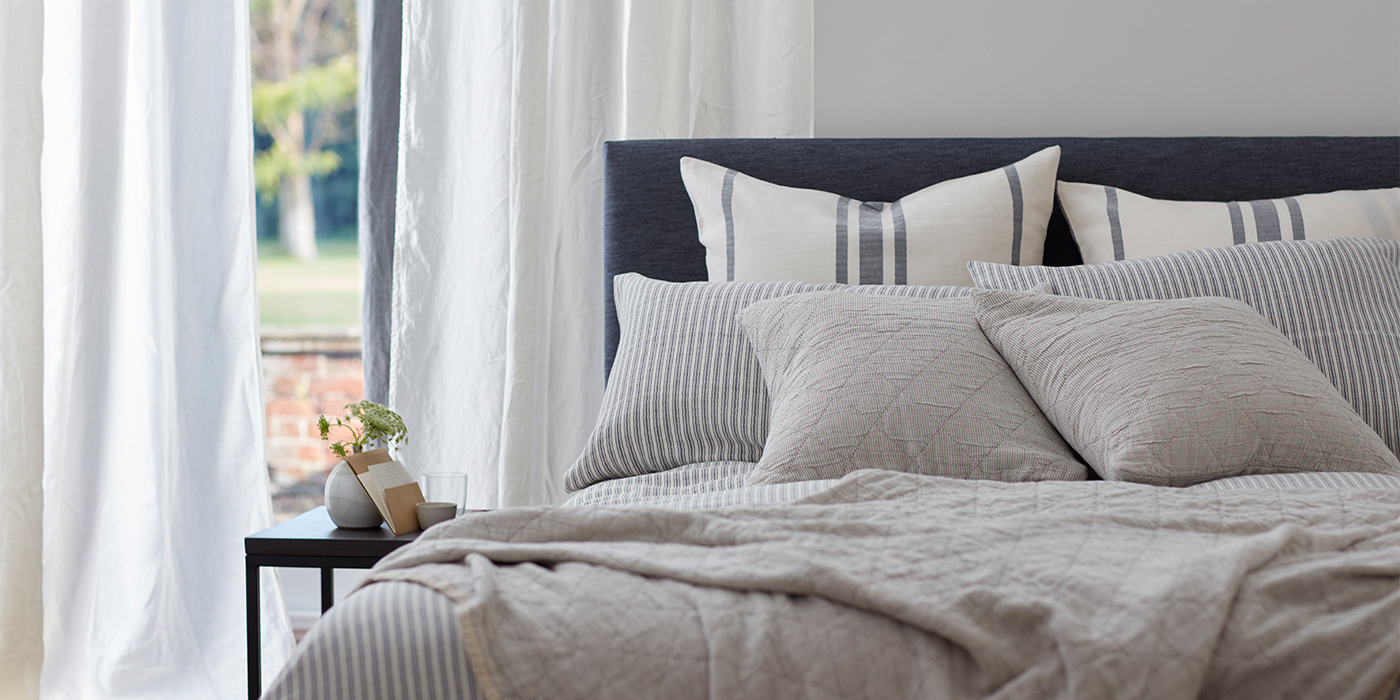 Ticking Stripe Grey Bedding in a Light and Airy Bedroom