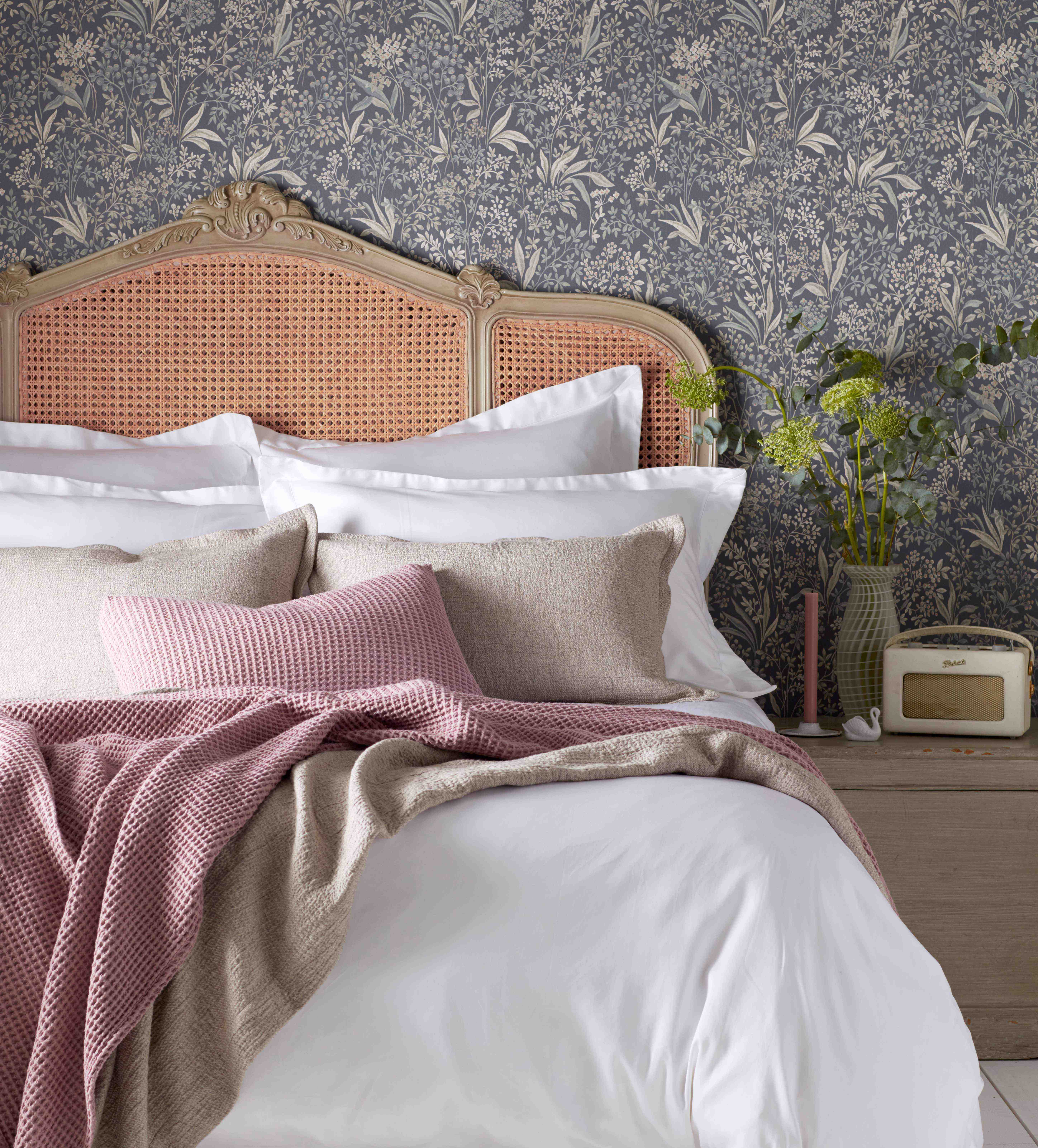 White Luxury Bedding Layered with Bedroom Accessories