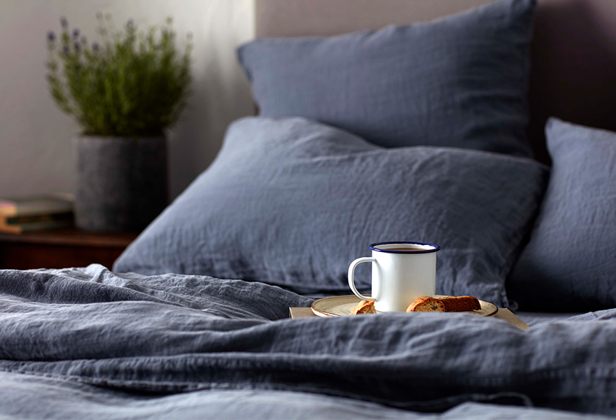French Blue Linen Bedding with an Enamel Mug